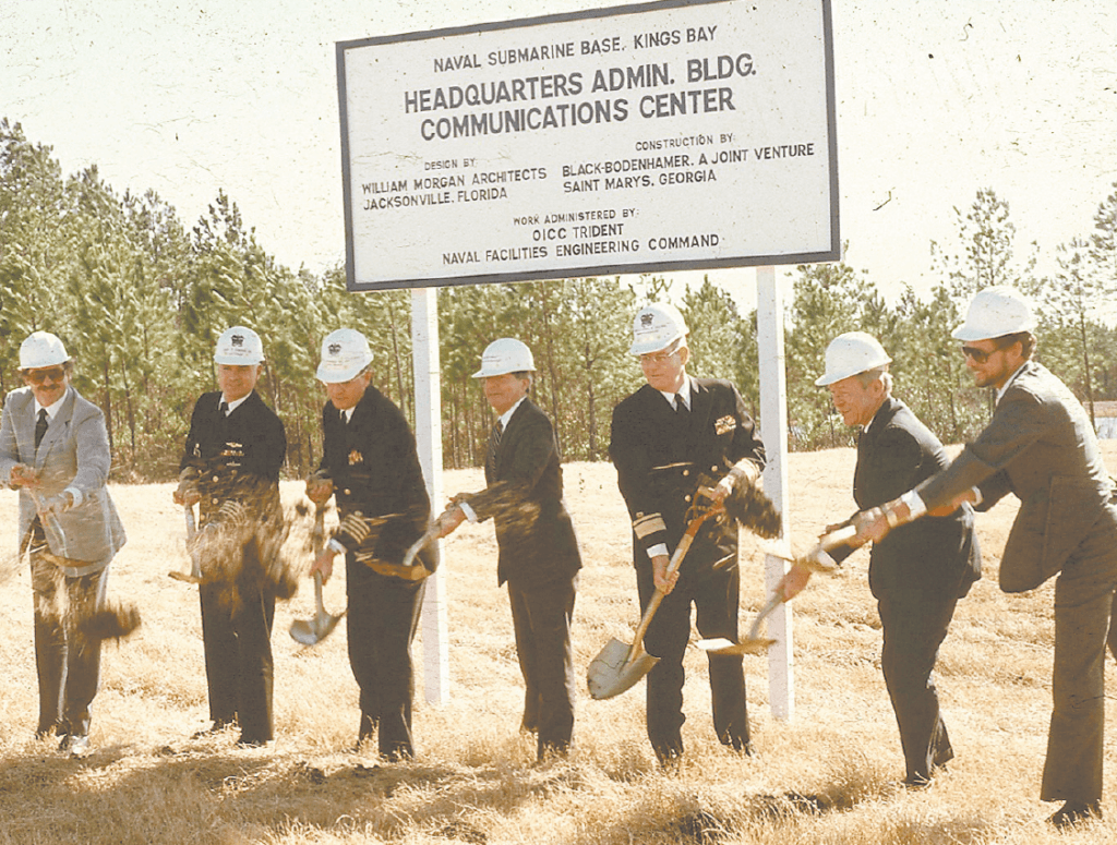 Civilians and Sailors break ground near an open field where the Headquarters Building at Fluckey Hall is today.