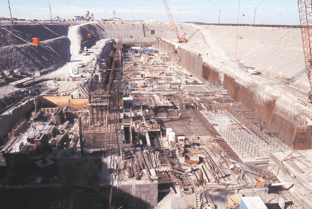 This photograph shows a massive pit filled with supplies for the construction of the dry dock in January of 1988.