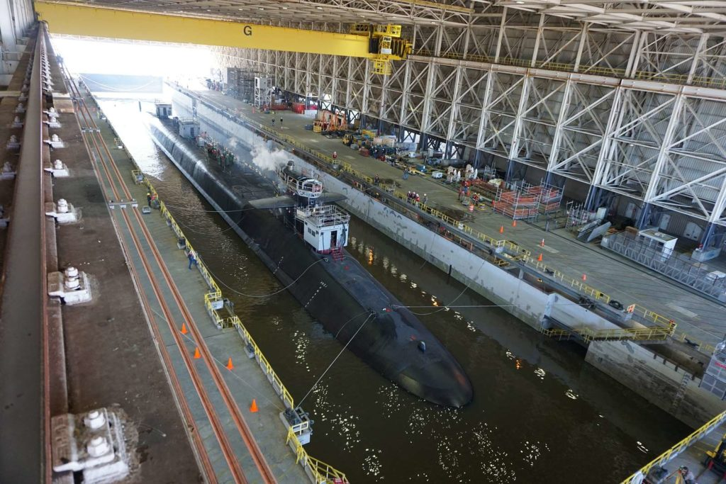 The USS Georgia prepares to exit the dry dock at Naval Submarine Base Kings Bay, Georgia, following an extended refit period.