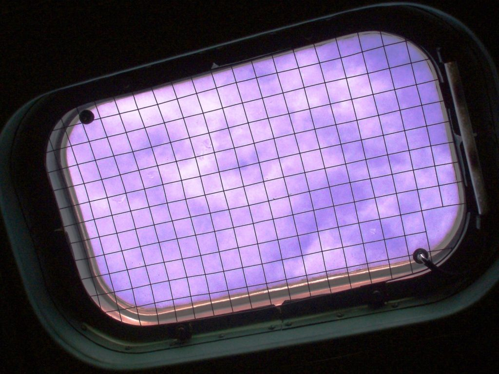 Windows with wire mesh for electromagnetic radiation protection.