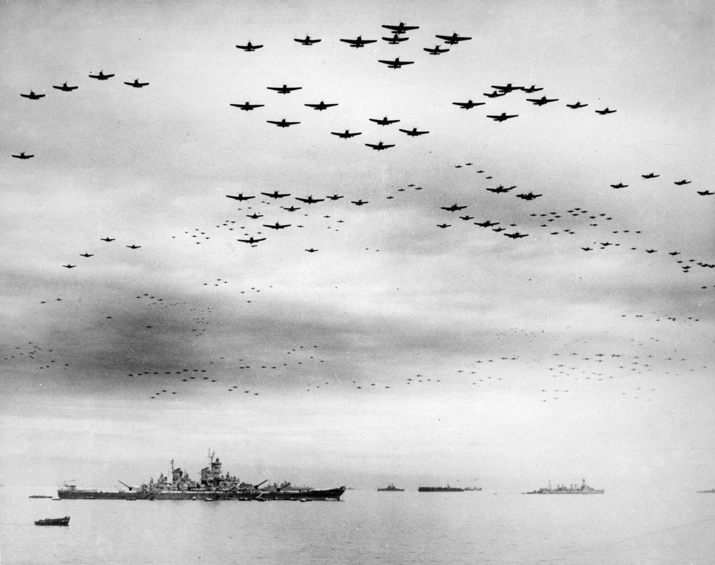 U.S. Navy carrier planes fly in formation over the U.S. and British fleets in Tokyo Bay